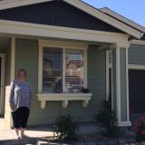 Cyndi Evans in front of her home