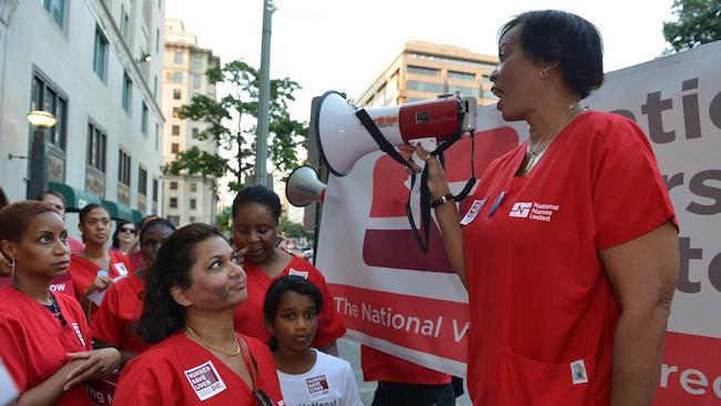 Nurse holds bullhorn