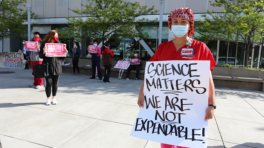 "Nurse holding sign ""Science matters, we are not expendable!"""