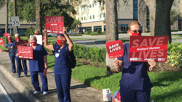 Nurses hold signs calling for hospital safety