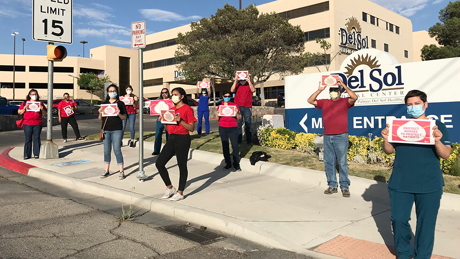 Nures hold signs calling for safety measures outside Del Sol Medical Center