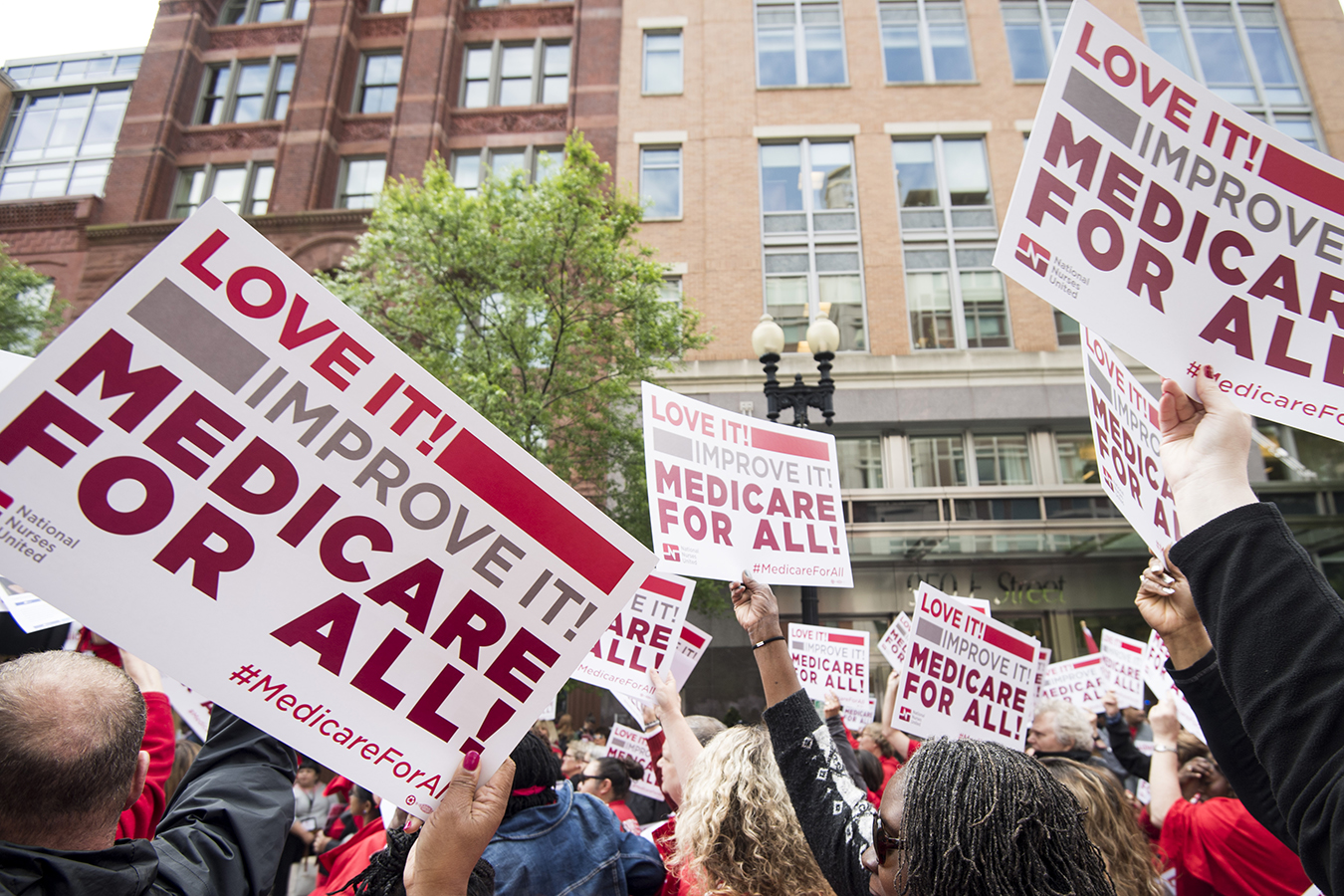 "National Nurses United union members wave ""Medicare-for-all"" signs"
