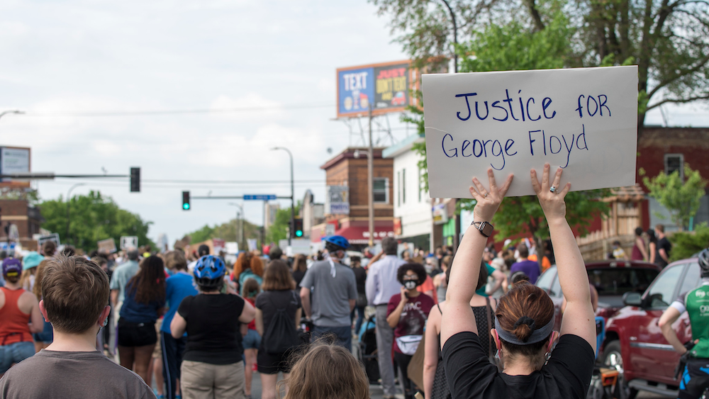 "Crowd with person holding sign ""Justice for George Floyd"""