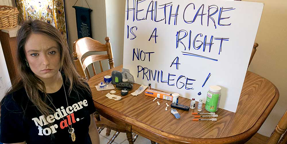 Briana Moss, 30, with the supplies she needs to survive type 1 diabetes.