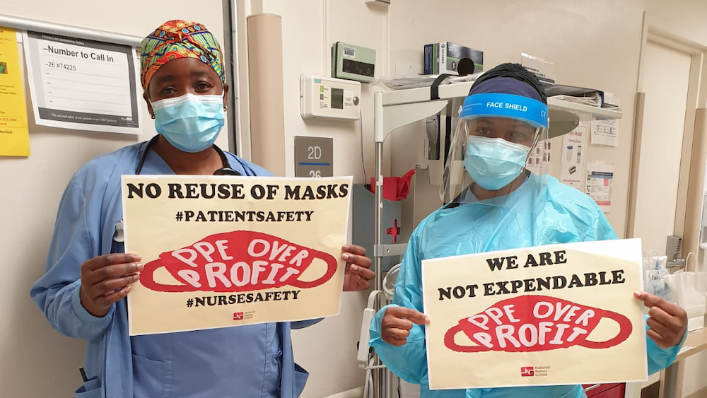 "MedStar nurses hold signs ""We are not expendable"""