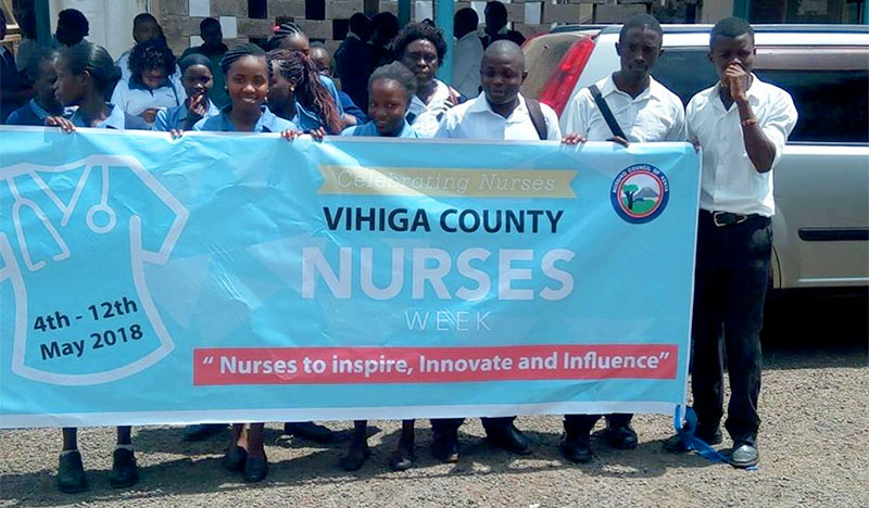 Kenyan Nurses with banner