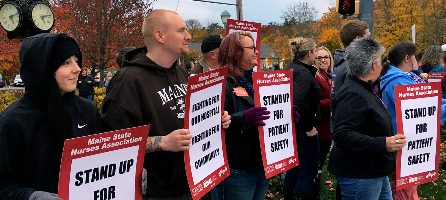 Nurses from Northern Light Hospital in Maine hold signs for patient safety