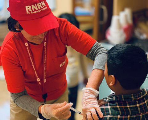 Nurse volunteering with RNRN
