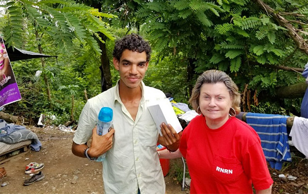 RNRN volunteer Betty Woods at a homeless encampment in Puerto Rico