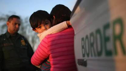 Child being separated from mother at border