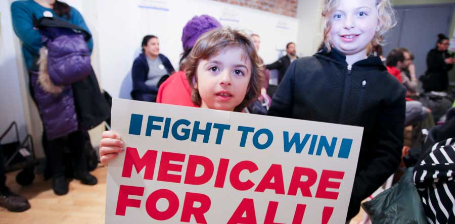 Girl holding medicare for all sign