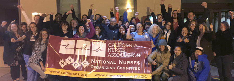 Barton Nurses in front of banner