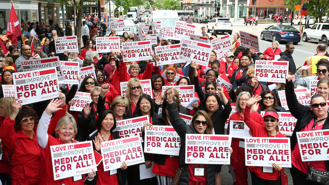 Nurses hold signs calling for Medicare for All