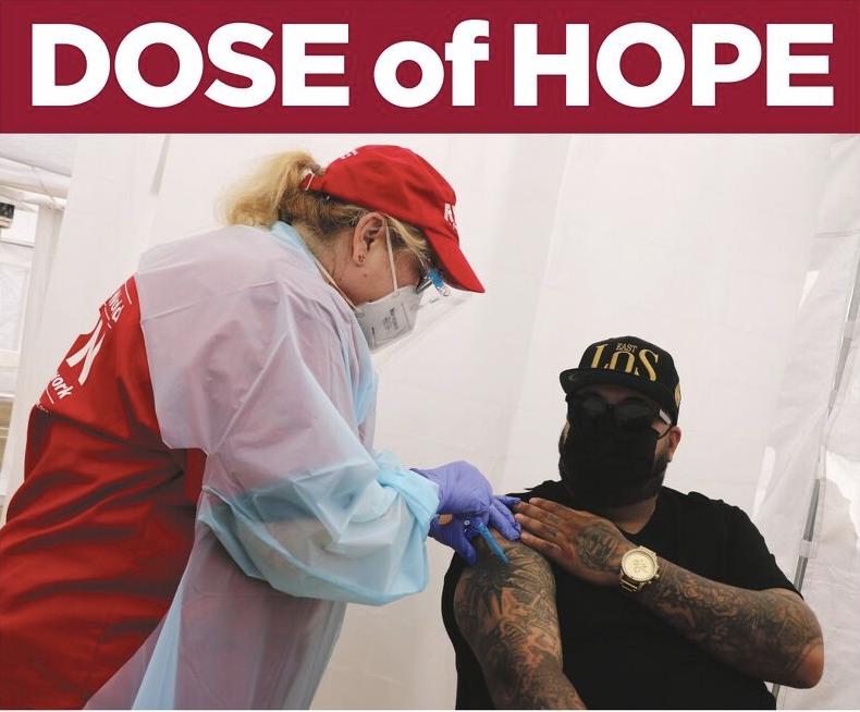 """Dose of Hope"" nurse administering vaccine"
