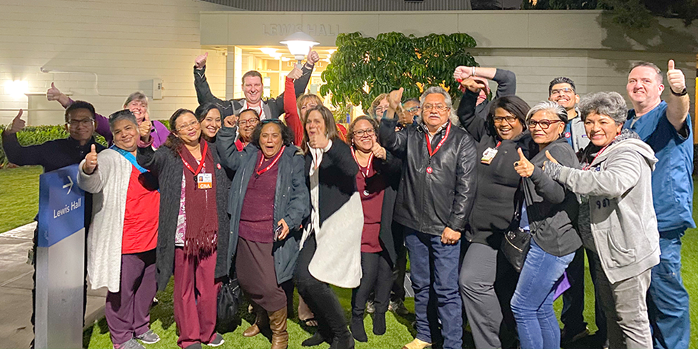 Health care workers and employees at Methodist Hospital in Arcadia give thumbs up