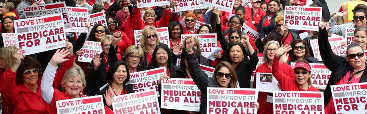 Nurses hold Medicare for All signs