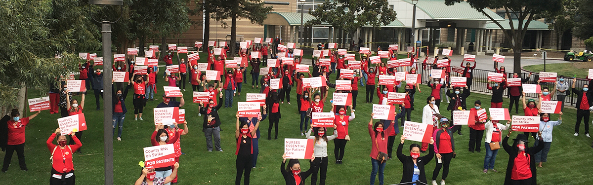 Striking San Joaquin County registered nurses in front of San Joaquin General Hospital