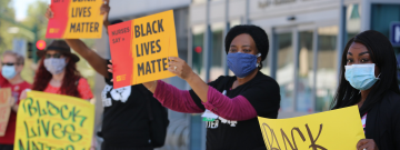 "Nurses hold ""Black Lives Matter"" signs"