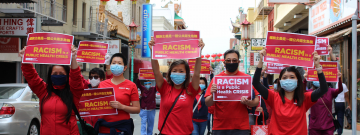 "Nurses march through Chinatown, San Francisco, holding ""Racism is a Public Health Crisis"" signs"