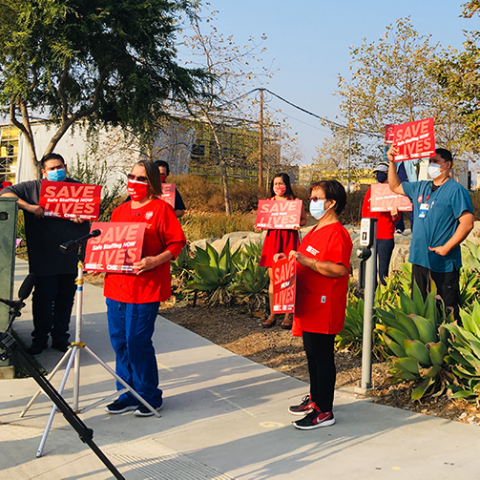 RNs and Caregivers from Palomar Health holding a press conference