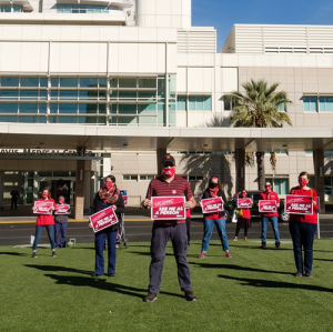 Nurses outside UC Davis Medical Center hold signs calling for safety measures