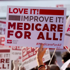 Nurse holding medicare for all sign