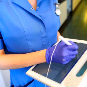 A nurse using a wireless electronic tablet