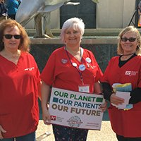 Florida nurses holding sign