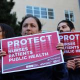 Nurses with protect signs