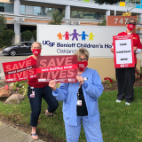 Nurses holds signs for safe staffing