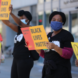 "Nurses holding signs ""Black Lives Matter"""