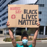"Nurse holds sign ""Nurses say Black Lives Matter"""