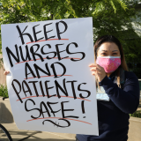 nurse holding sign