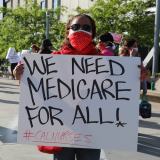 "Nurse holding sign ""We need Medicare for All"""