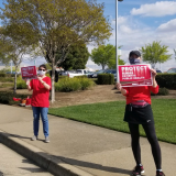 "Nurses hold ""Protect Nurses"" signs"