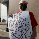 Nurse holding signs promoting public safety