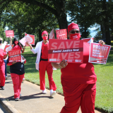 "Nurses holds signs ""Racial Justice Now"" and ""Protect Nurses"""