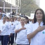 Argentina nurses with hands over hearts